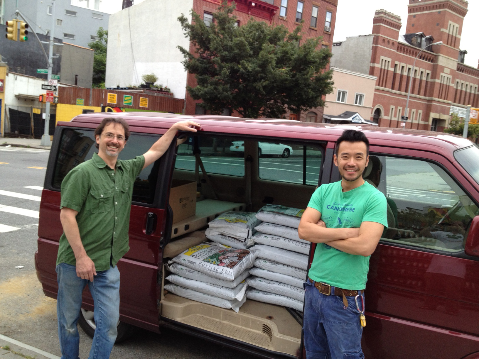 John (Bitters And Ester) And Kenneth (The Winey Neighbor) Picking Up The  Potting Soil From Natty Garden And Distribute Them To Designated Tree Pits.